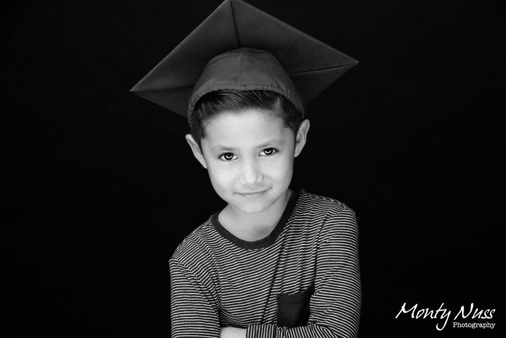 black white graduation cap striped shirt indoor studio