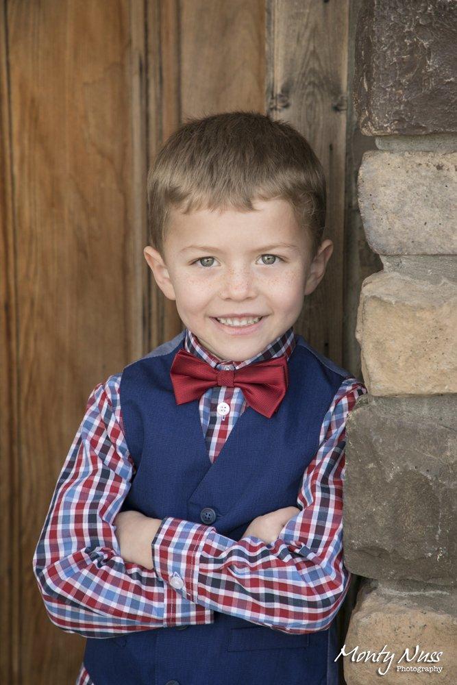 bow tie wood door stone plaid shirt sweater vest