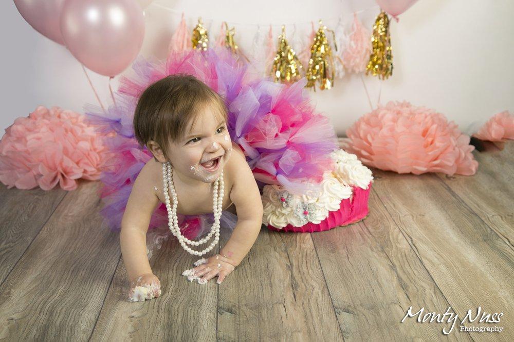 brown hair baby pearls pom poms tassels balloons