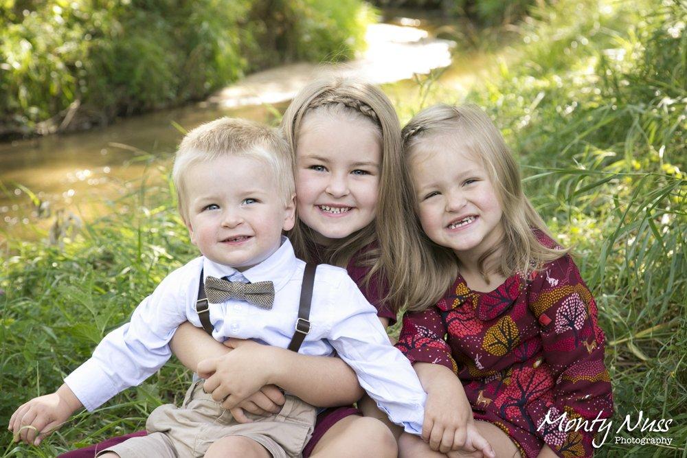family hugging equestrian park littleton colorado water green grass