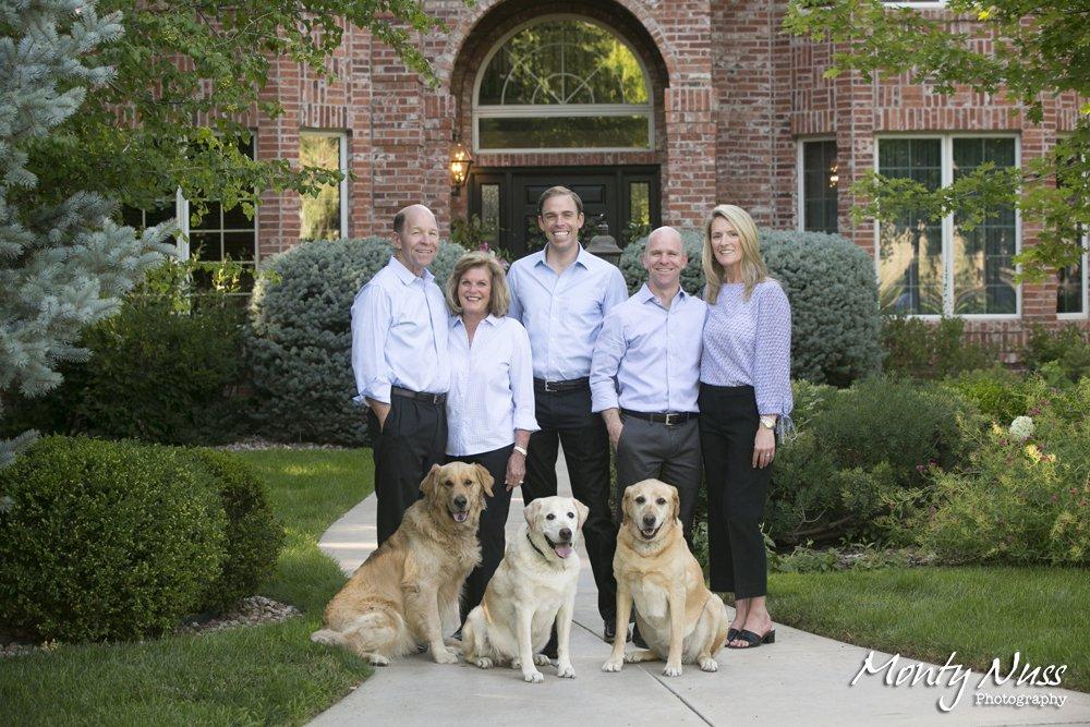 formal family portrait dogs brick