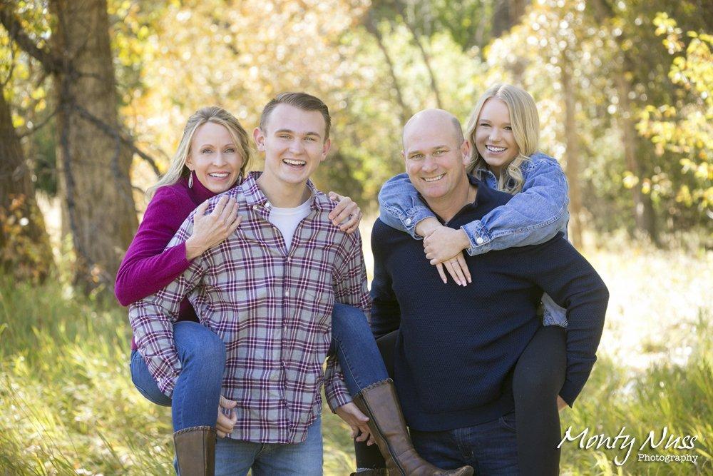 piggy back pose family portrait