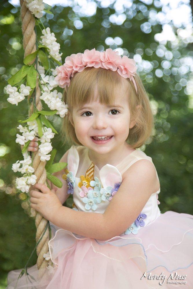pink fluffy dress flowers swing headband outdoor greenery professional photography